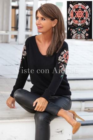 Suéter punto mangas bordadas